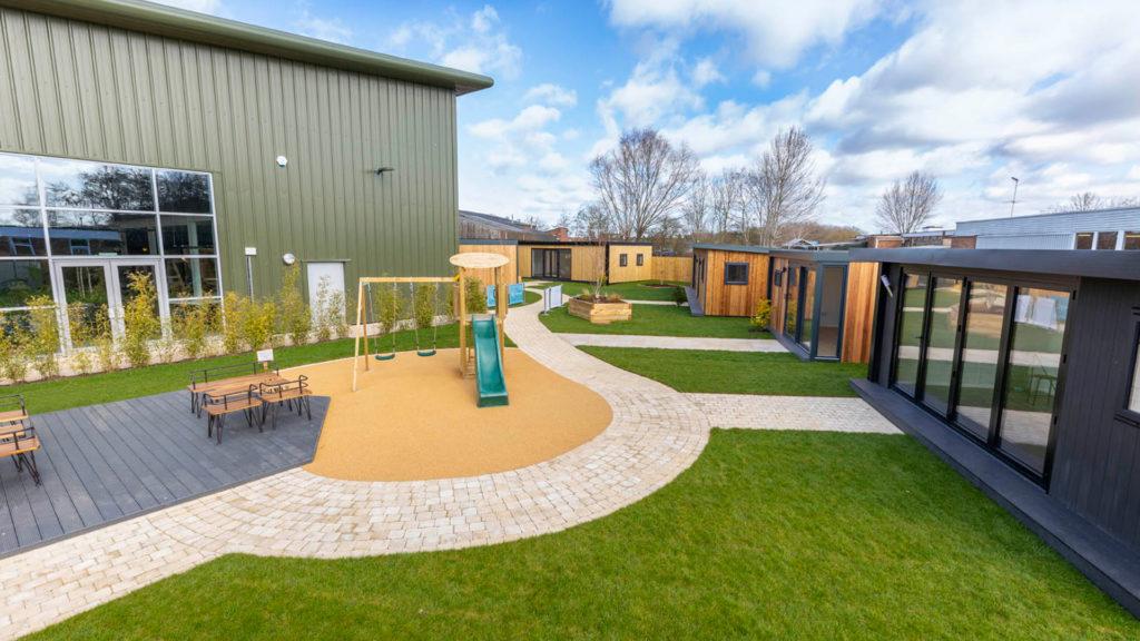 Green Retreats outdoor showroom with kids play area