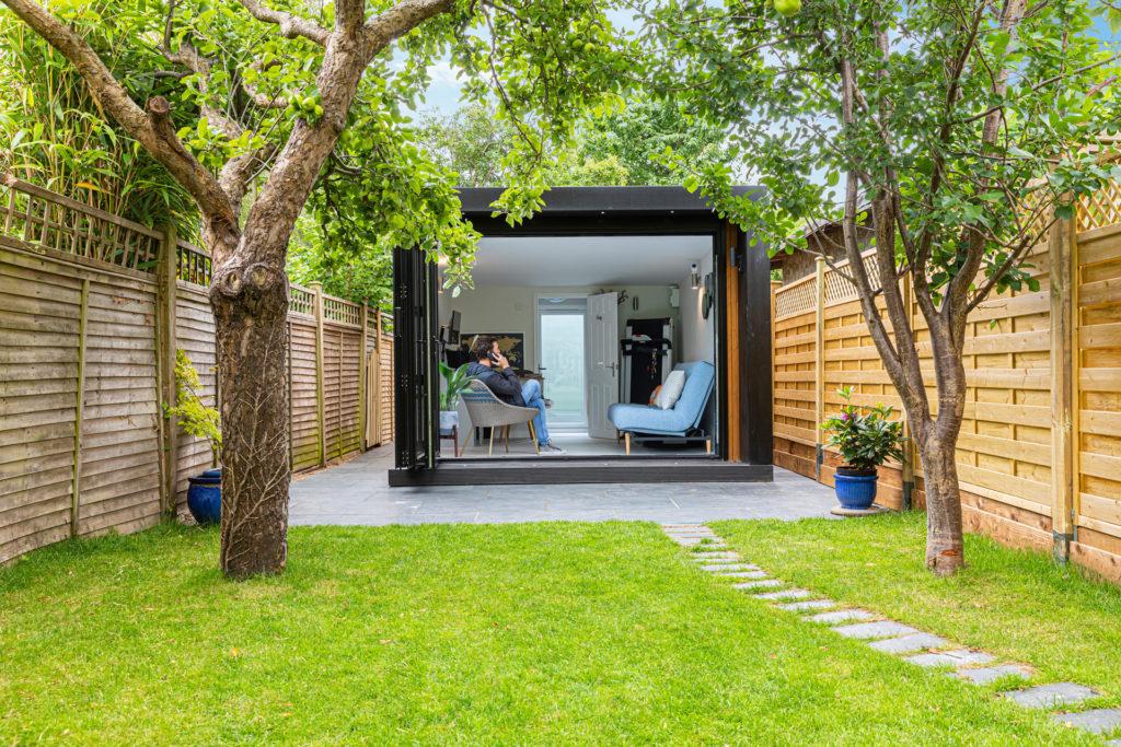 modern narrow garden office building