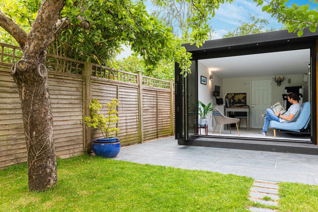 garden spare room with bi-fold doors