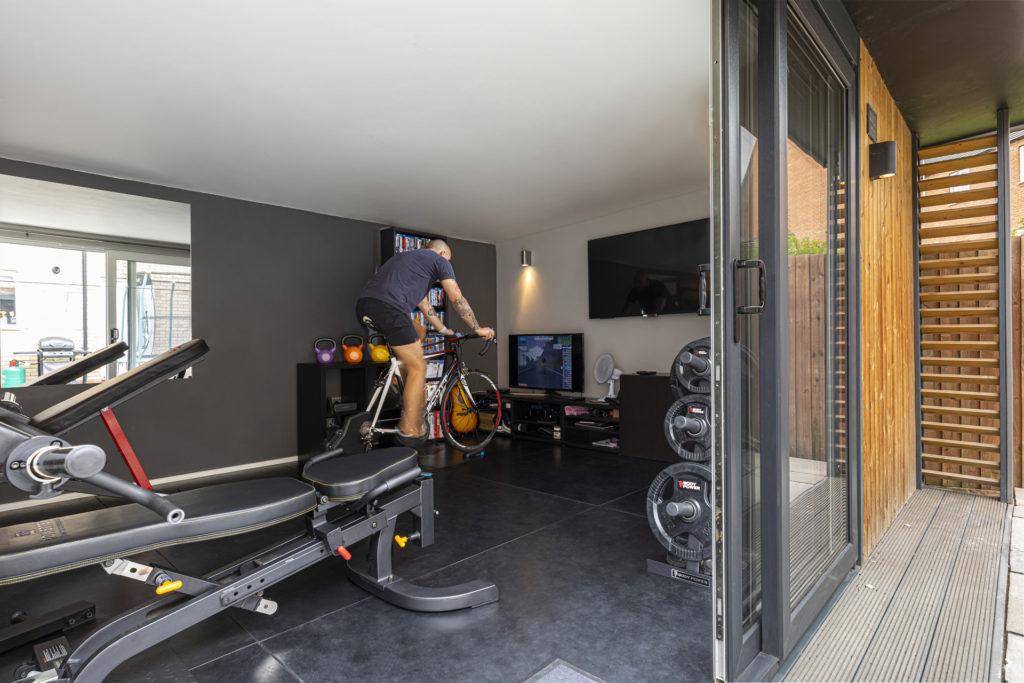 zwift home gym set up in a garden gym