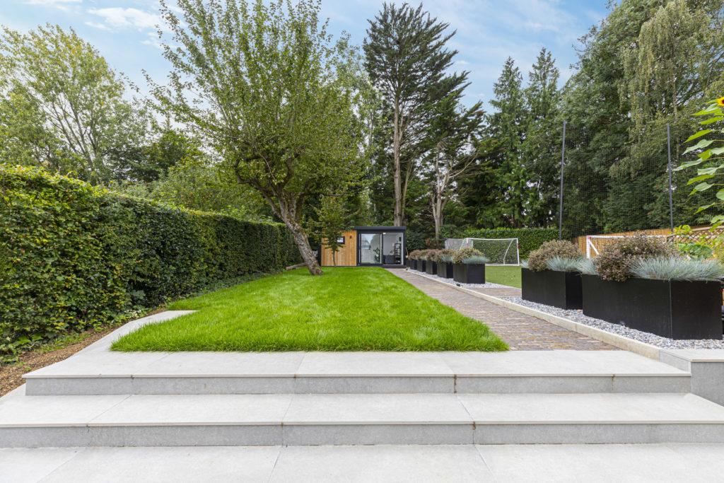 landscaped garden with garden gym building