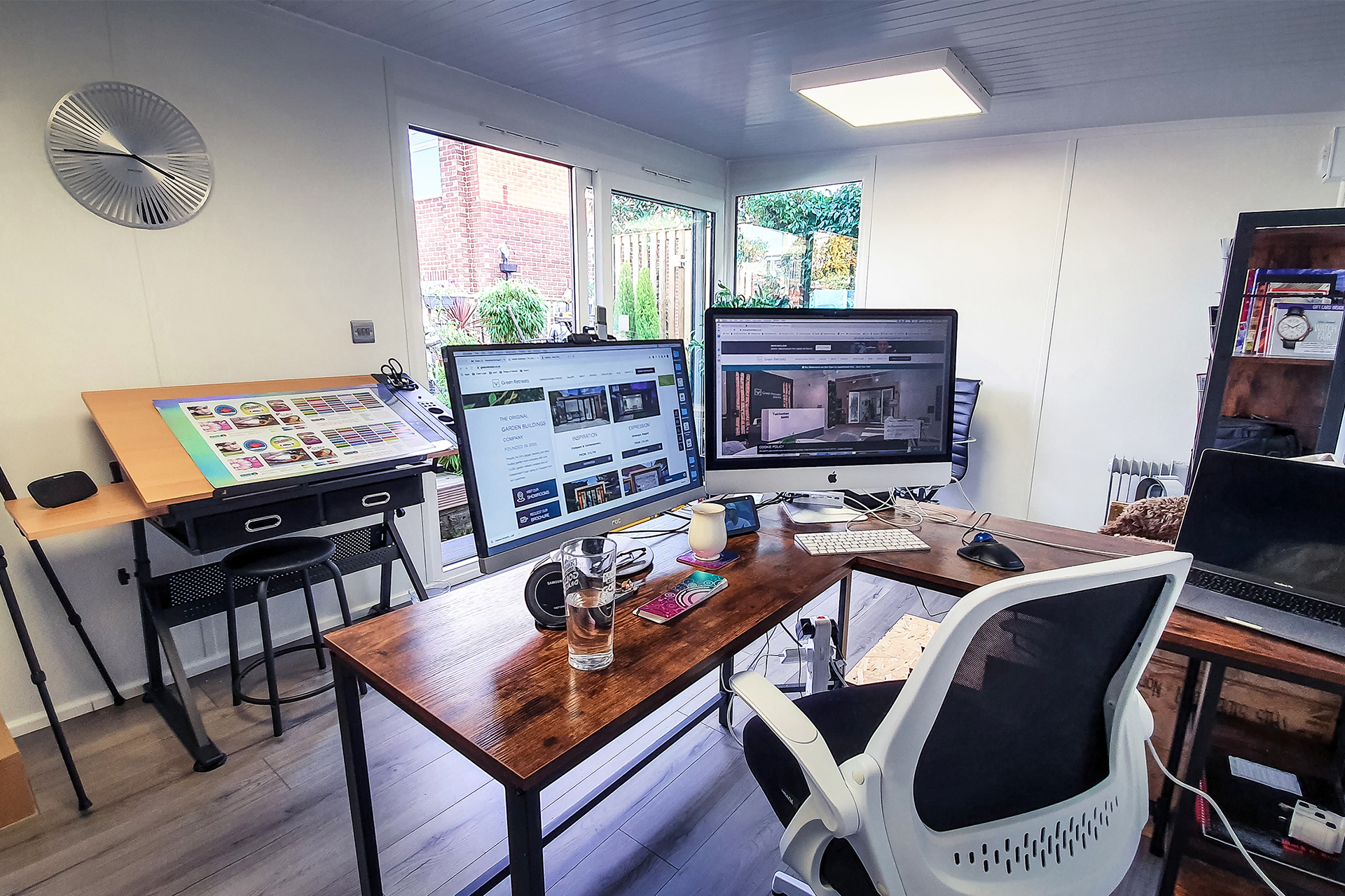 Home garden office with desks and computers