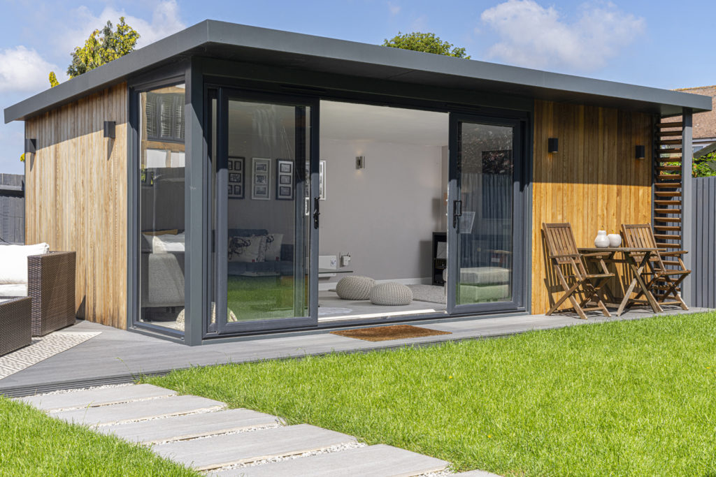 Exterior of a garden room with a bistro set at the front