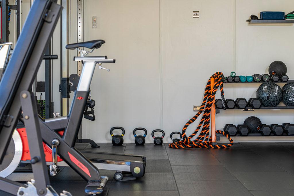 Interior of a home gym with gym equipment inside